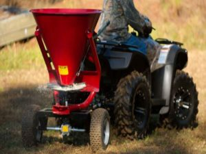 Testing different spreaders to find the best ATV spreader for seeds, fertilizer