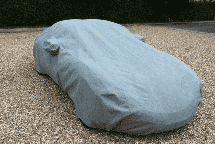 Car left outside with an car cover